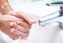 man washing hands germophobia