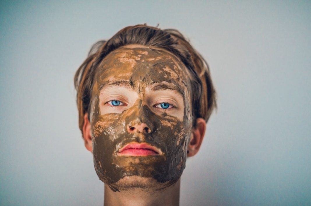 woman with facial mask on face