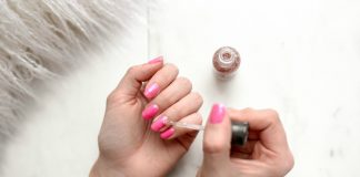 woman manicuring her nails