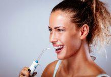 young girl washing teeth oral hygiene