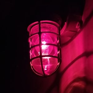 red light bulb on the wall