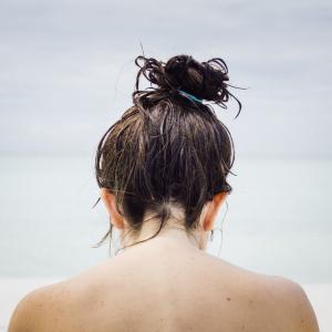 woman facing seashore
