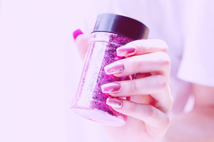 person holding pink container
