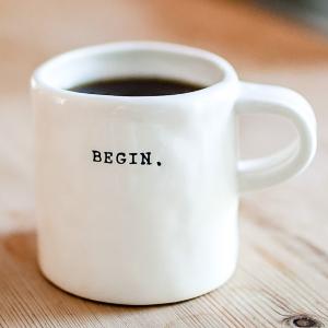 hite ceramic mug on table