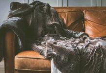 brown leather sofa and blanket