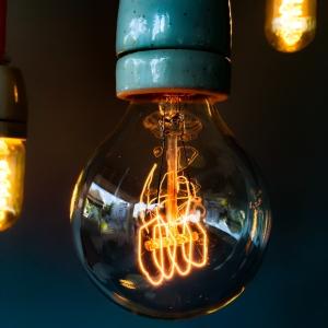 turned on clear glass light bulb